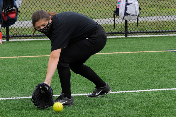 TIM JEAN/Staff photo<br /> <br /> Vanessa Palmacci, 13, works on her backhand technic  during a softball clinic held at Haverhill High School.   8/27/20