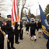 CARL RUSSO/Staff photo. GAZETTE: The USS Constitution Honor Guard, right, marches pass the North Andover Fire Dept. Honor Guard during the ceremony.  The Industrial Bridge on Ferry Road in Bradford was dedicated to U.S. Navy Petty Officer, Caitlin Trask of North Andover and Bradford Saturday morning. This is the first bridge in the country ever dedicated to a female service member.<br /> Caitlyn Trask, U.S. Navy Petty Officer Third Class, was just 20 years old when she was killed by her ex-boyfriend, a fellow sailor, at a military housing complex in Virginia in 2009. 4/14/2018