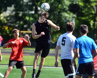 CARL RUSSO/Staff photo Haverhill junior, Connor Buscema gets in the middle of the action to head the ball.   The Haverhill high boys soccer teams (varsity and JV) held their first Saturday morning soccer practice on the new high school field. 8/24/2019