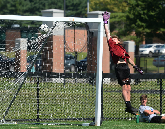 CARL RUSSO/Staff photo Haverhill sophomore goal keeper, Tyler Carroll makes a great attempt with a high reach to make the save but was unsuccessful during a practice scrimmage.    The Haverhill high boys soccer teams (varsity and JV) held their first Saturday morning soccer practice on the new high school field. 8/24/2019