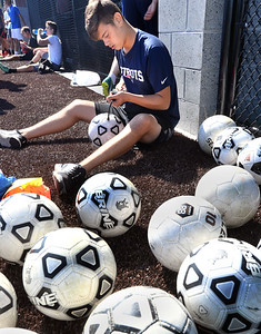 CARL RUSSO/Staff photo  Haverhill sophomore, Christian Melo adds air to the soccer balls before practice.   The Haverhill high boys soccer teams (varsity and JV) held their first Saturday morning soccer practice on the new high school field. 8/24/2019