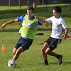 CARL RUSSO/staff photo. Haverhill high senior soccer captains, Alexander Melo, left and Ian Miller fight for the ball during a practice scrimmage. The Haverhill high boys soccer team held practice Friday afternoon. 8/24/2018