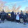 ALLISON CORNEAU/Staff photo<br /> Batman, left, and Superintendent Margaret Marotta, far right, are joined at Bradford Elementary by, from left, ESP Michelle Goldsten and students Viviahna Torres, Jacob Lubowa, Kallie McHenry, teacher Kirsten Fried, Jendiah DeLeon-Caceres, Justin Acosta-Parez and Lola Wilson.