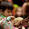 TIM JEAN/Staff photo <br /> <br /> Christoper Piandee, 4, reaches out to touch a hedgehog during Curious Creatures live animal program at the Haverhill Public Library.   1/3/20