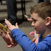 TIM JEAN/Staff photo <br /> <br /> Brendan Doyle, 6, pets a crested gecko during Curious Creatures live animal program at the Haverhill Public Library.   1/3/20