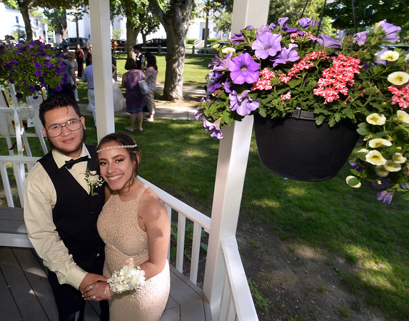 CARL RUSSO/Staff photo. GAZETTE: Whittier Tech senior, Jonathan Roux of Haverhill and his date Whittier Tech 2017 graduate, Roselly Lassus of Haverhill have their picture taken in the Bradford Common gazebo. Haverhill High School and Whittier Tech. High School seniors gathered at the Bradford Common for photos before attending their proms Tuesday night.  5/29/2018