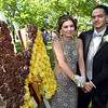 CARL RUSSO/Staff photo. GAZETTE: Haverhill high senior, Ynez Maldonado and her date, Luis Chavarria, Haverhill high 2017 graduate pose next to a display of flowers in the shape of the letter H. Haverhill High School and Whittier Tech. High School seniors gathered at the Bradford Common for photos before attending their proms Tuesday night.  5/29/2018