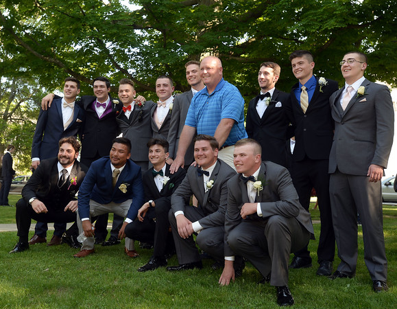 CARL RUSSO/Staff photo. GAZETTE: Whittier Tech Wildcats football coach, Kevin Bradley has his picture taken with the senior members of his team attending the prom. Haverhill High School and Whittier Tech. High School seniors gathered at the Bradford Common for photos before attending their proms Tuesday night.  5/29/2018