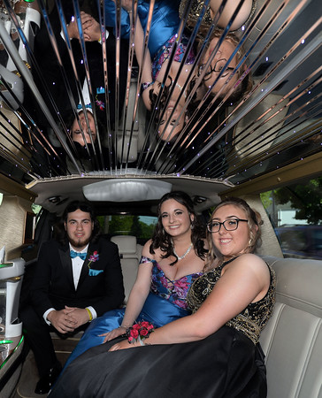 CARL RUSSO/Staff photo. GAZETTE:  From left, Addison Nichols, a junior at Whittier Technical high escorts Whittier seniors, Sophia Eisenhaure and Sarah Bussey to their prom in style in a Black Tie Limousine. Haverhill High School and Whittier Tech. High School seniors gathered at the Bradford Common for photos before attending their proms Tuesday night on 5/29.  5/29/2018