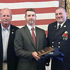 TIM JEAN/Staff photo<br /> <br /> Event chairperson Dan Giuliani, center, presents Firefighter of the Year award to Lt. Christopher Cesati, right, who was introduced by Bill Laliberty, retired Haverhill Fire Chief during the Exchange Club of Haverhill Annual First Responders Award Luncheon held at Maria's Family Restaurant in Haverhill.  6/3/21