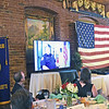TIM JEAN/Staff photo<br /> <br /> A video plays and screen of  Firefighter of the Year award recipient Lt. Christopher Cesati during the Exchange Club of Haverhill Annual First Responders Award Luncheon held at Maria's Family Restaurant in Haverhill.  6/3/21