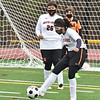 CARL RUSSO/staff photo Greater Lawrence's Kaylie Ortiz clears the ball in front of her net. Whittier Tech. high school defeated Greater Lawrence Tech. 7-0 in boys'  soccer action Wednesday afternoon. 3/24/2021