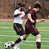 CARL RUSSO/staff photo Whittier's Sean Ruane fights for the ball with Greater Lawrence's Kaylie Ortiz. Whittier Tech. high school defeated Greater Lawrence Tech. 7-0 in boys'  soccer action Wednesday afternoon. 3/24/2021