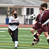 CARL RUSSO/staff photo Whittier's Sean Ruane controls the ball as Greater Lawrence's Briana Peralta moves in. Whittier Tech. high school defeated Greater Lawrence Tech. 7-0 in boys'  soccer action Wednesday afternoon. 3/24/2021