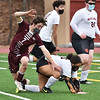 CARL RUSSO/staff photo Whittier's Lukas Rousseau collides with Greater Lawrence's Emily Then chasing the ball. Whittier Tech. high school defeated Greater Lawrence Tech. 7-0 in boys'  soccer action Wednesday afternoon. 3/24/2021