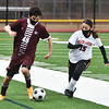 CARL RUSSO/staff photo Whittier's Carlos Hernandez moves the ball as Greater Lawrence's Briana Peralta gives  chase. Whittier Tech. high school defeated Greater Lawrence Tech. 7-0 in boys'  soccer action Wednesday afternoon. 3/24/2021