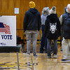 CARL RUSSO/staff photo People line up to vote at Ward 1, Precinct 1, Consentino Middle School in Haverhill.  Haverhill residents voted in Tuesday's presidential election.11/03/2020