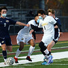 CARL RUSSO/Staff photo.  Andover's Emerson Lund, 9 and Haverhill's Drew Roberts, 9 fight for the ball along the sideline with other players. Down 3-0 at the half, the Haverhill Hillies rallied back to score three goals, ending the game in a tie against Andover in boys' soccer action Wednesday afternoon. 11/04/2020