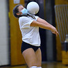CARL RUSSO/staff photo. Junior varsity player, freshman Mikayla Tzortzis avoids getting hit in the face as she returns the serve. The Haverhill Hillies' volleyball teams have been getting ready for the season to open. <br /> <br /> The varsity and junior varsity (seen here) practiced on Friday, October 16 to get ready for their first away game on Saturday, October 17 against Dracut high. 10/16/2020