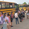 TIM JEAN/Staff photo<br /> <br /> Haverhill students get off busses and line up to check in with teachers outside Golden Hill Elementary School on the first day of school.   8/31/21