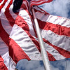 TIM JEAN/Staff photo<br /> <br /> The flag in honor of Marine Sgt. Johanny Rosario, 25, of Lawrence, who was killed in Kabul, Afghanistan. Thirteen American flags with names written on each one of the poles for the U.S. service members killed in the suicide bombing attack in Kabul Afghanistan is on display at the edge of a home at 749 Main St., Haverhill. They are also light up at night.   9/2/21