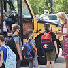 TIM JEAN/Staff photo<br /> <br /> Fourth grade teacher JoAnn Atwood, right, welcomes back students as they get off busses outside Golden Hill Elementary School on the first day of school in Haverhill.  8/31/21