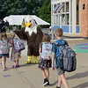TIM JEAN/Staff photo<br /> <br /> Haverhill students walk towards the playground as they high-five their school's mascot outside Golden Hill Elementary School on the first day of school.   8/31/21