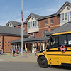 TIM JEAN/Staff photo<br /> <br /> Busses drop off students outside of the Golden Hill Elementary School on the first day of school in Haverhill.  8/31/21