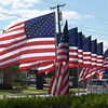 TIM JEAN/Staff photo<br /> <br /> Thirteen American flags with names written on each one of the poles for the U.S. service members killed in the suicide bombing attack in Kabul Afghanistan. The flags are placed at the edge of a home at 749 Main St., Haverhill. They are also light up at night.   9/2/21