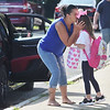 TIM JEAN/Staff photo<br /> <br /> Nelia Sanchez, left, kisses goodbye to her granddaughter Isabelle Florence, a first grader outside Golden Hill Elementary School on the first day of school in Haverhill.  8/31/21