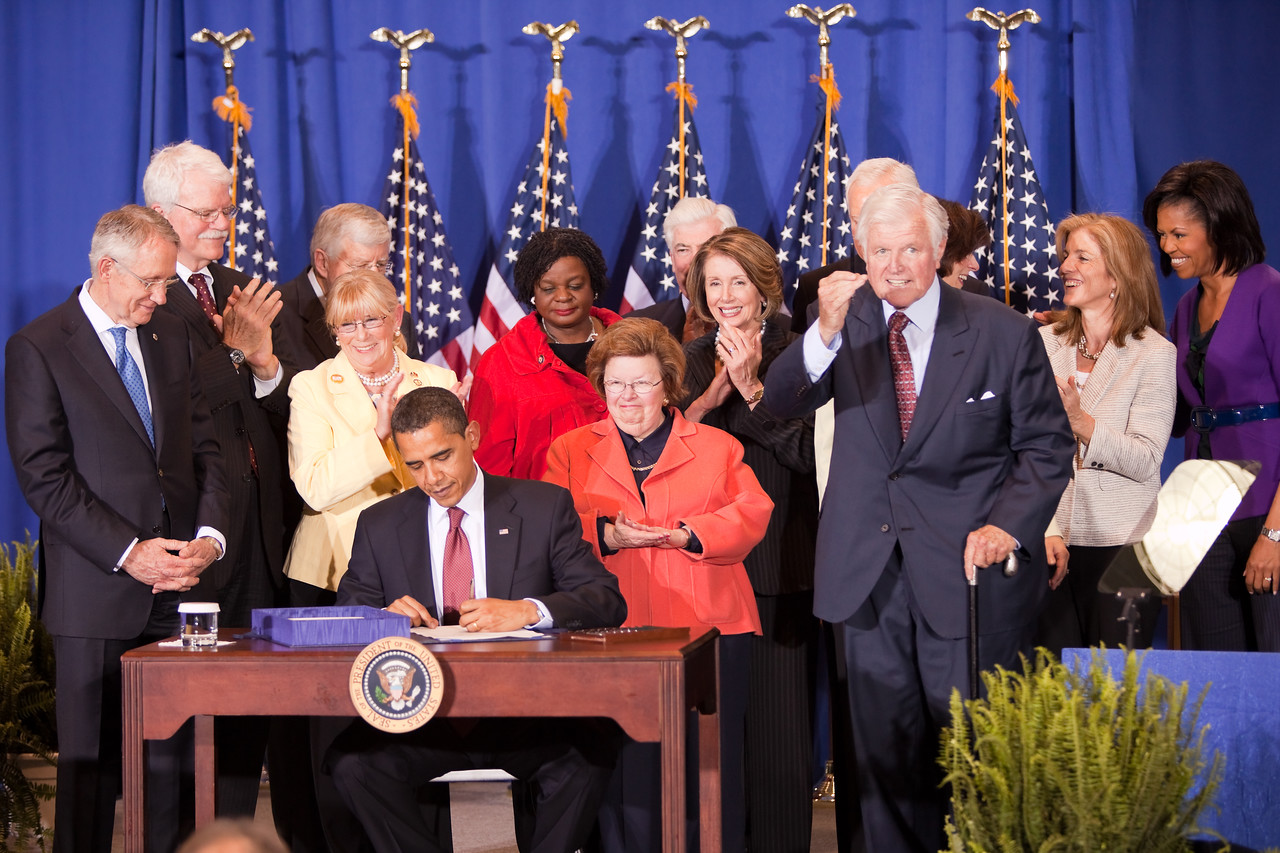 President Barack Obama signs the Edward M. Kennedy Serve America Act on April 21, 2009, at a Washington, DC, elementary school, joined by Vice President Biden, First Lady Michelle Obama, Dr, Jill Biden, Members of Congress, former President Clinton, former First Lady Rosalyn Carter, and an audience of nonprofit leaders and national service volunteers. The bill's namesake and longtime service champion Sen. Kennedy co-authored the legislation with Sen. Orrin Hatch. Corporation for National and Community Service Photo.