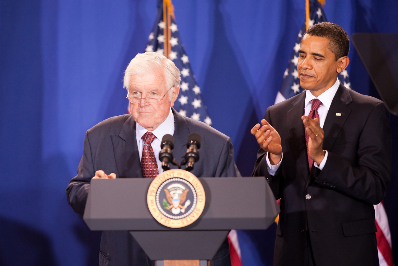 Massachusetts Sen. Edward Kennedy speaks prior to the signing of the Edward M. Kennedy Serve America Act named in his honor as President Barack Obama looks on during a ceremony in Washington, DC, on April 21, 2009.