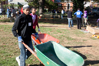 Two young people clear debris at a KaBOOM! playground build on October 23, 2010. More than 500 volunteers from the White House, the Corporation for National and Community Service, federal agencies and the local community volunteered as part of Make a Difference day. 2010 marked the 20th anniversary of this day, an effort led by USA Weekend and the HandsOn Network. Together these volunteers build a complete playground in just under six hours at Hyde Leadership Public Charter School.   Attendees included Secretary Arne Duncan, from the Department of Education; Secretary Tom Vilsack, from the Department of Agriculture; Secretary Ray LaHood from the Department of Transportation; Secretary Tom Donovan from the Department of Housing and Urban Development and Corporation for National and Community Service CEO Patrick Corvington.