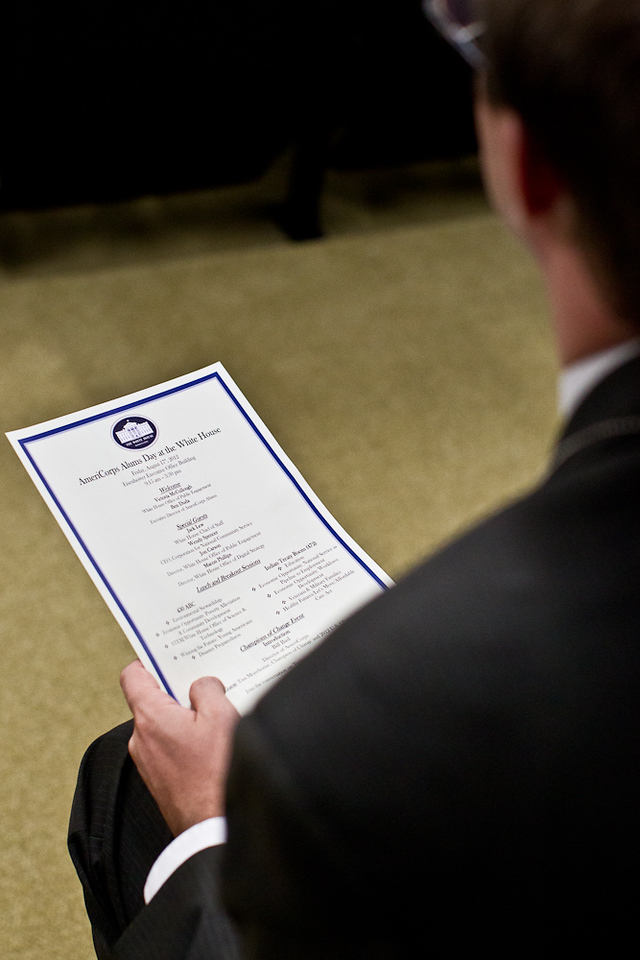 An AmeriCorps Alum holds the itinerary of the AmeriCorps Alums Day at the White House. Corporation for National and Community Service Photo.
