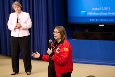 A City Year AmeriCorps Alum member talks to the audience and to Wendy Spencer, Ceo for National and Community Service. Corporation for National and Community Service Photo.