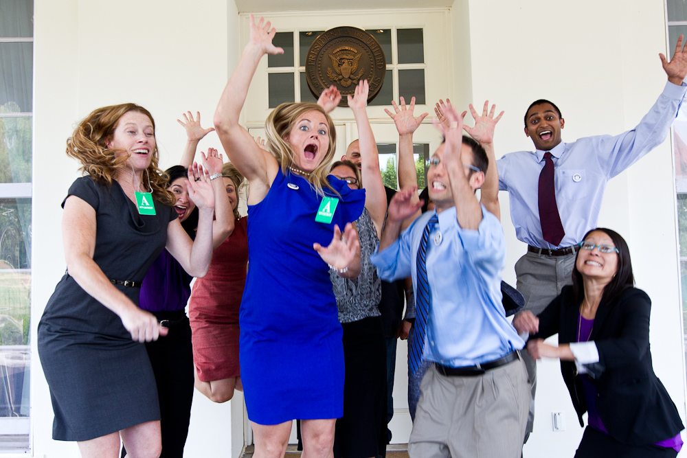 The AmeriCorps Alums, Champions of Change jump for joy at the White House. Corporation for National and Community Service Photo.