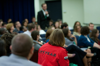A City Year AmeriCorps alum member watches as another alum shares his Americorps story to the audience. Corporation for National and Community Service Photo