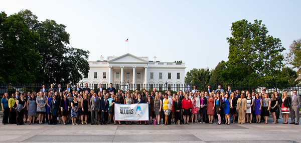 AmeriCorps Champions of Change and Alum stand in front of the White House for a group photo with their Alums banner. Corporation for National and Community Service Photo.
