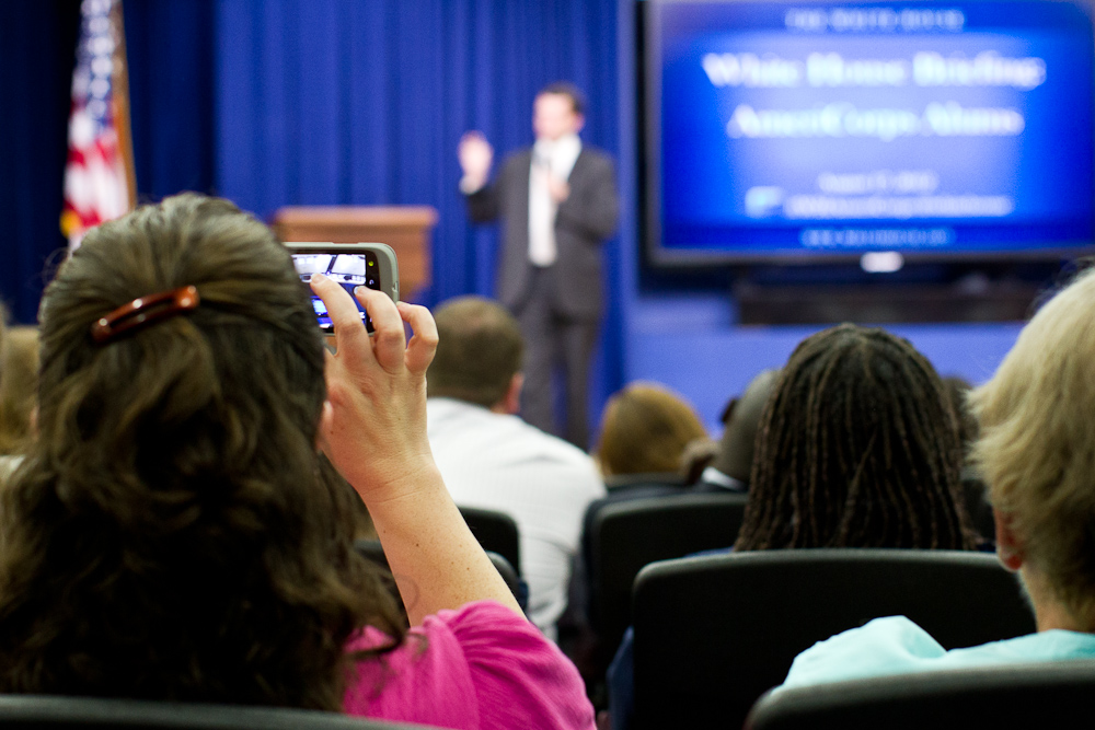 An AmeriCorps Alum, takes a photo video speaker, Jon Carson, Director White House Office of Public Engagement. Corporation for National and Community Service Photo.