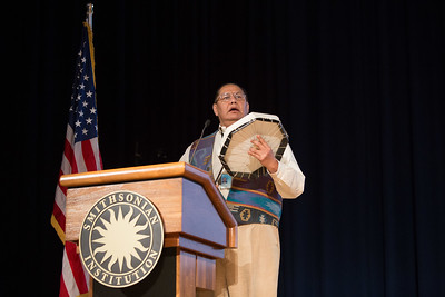 Dennis Zotigh Museum Cultural Specialist at the Smithsonian National Museum of the American Indian leading the celebration with a drumming ritual. Corporation for National and Community Service Photo.