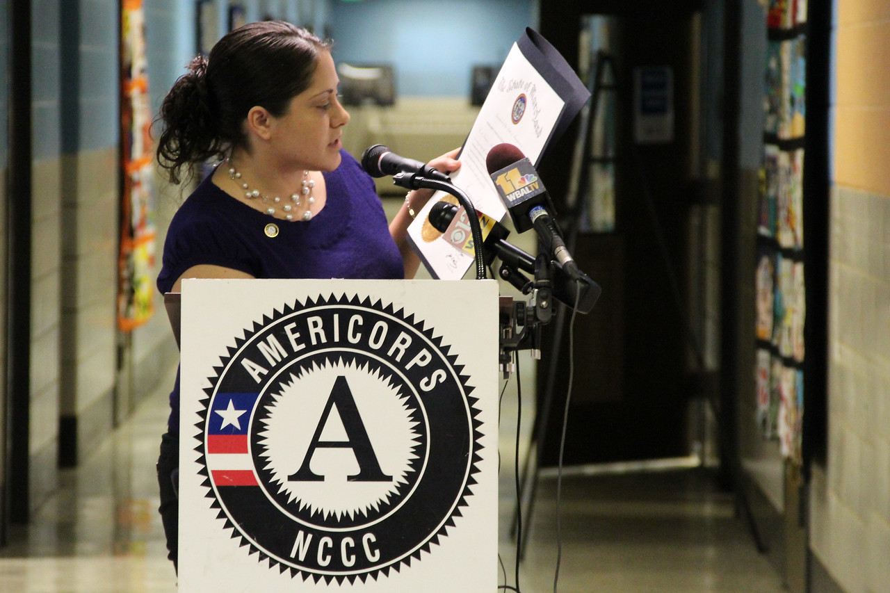Shaina Hernandez, Special Assistant to the Chief of Staff in the office of Gov. Martin O'Malley and AmeriCorps NCCC alumna, presents a citation from Gov. O'Malley at the dedication of the future home of the AmeriCorps NCCC Atlantic Region Campus in Baltimore, MD. Corporation for National and Community Service Photo.