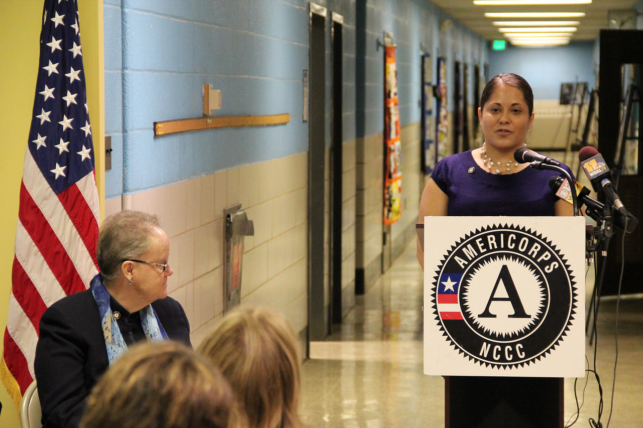 Shaina Hernandez, Special Assistant to the Chief of Staff in the office of Gov. Martin O'Malley and AmeriCorps NCCC alumna, addresses community members and attendees at the dedication of the future home of the AmeriCorps NCCC Atlantic Region Campus in Baltimore, MD. Corporation for National and Community Service Photo.