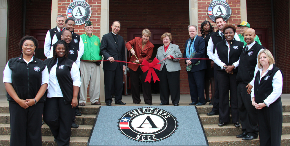 CNCS CEO Wendy Spencer, Sen. Barbara Mikulski, Archbishop William E. Lori, and AmeriCorps NCCC Director Kate Raftery join the staff of the AmeriCorps NCCC Atlantic Region Campus in cutting the ribbon on their future home in Baltimore, MD. The new campus will be located at the former Sacred Heart of Mary School and will be open in spring of 2013. Corporation for National and Community Service Photo.