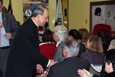 Archbishop William E. Lori greets community members at the future home of the AmeriCorps NCCC Atlantic Region Campus in Baltimore, MD. Corporation for National and Community Service Photo.