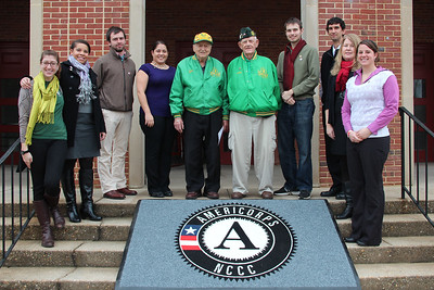 Civilian Conservation Corps (CCC) alumni Joseph De Cenzo and George B. Smith join AmeriCorps NCCC alumni and staff outside the future home of the AmeriCorps NCCC Atlantic Region Campus in Baltimore, MD. Corporation for National and Community Service Photo.