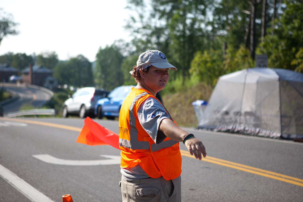 AmeriCorps NCCC member directing traffic at a service project. Corporation for National and Community Service Photo.