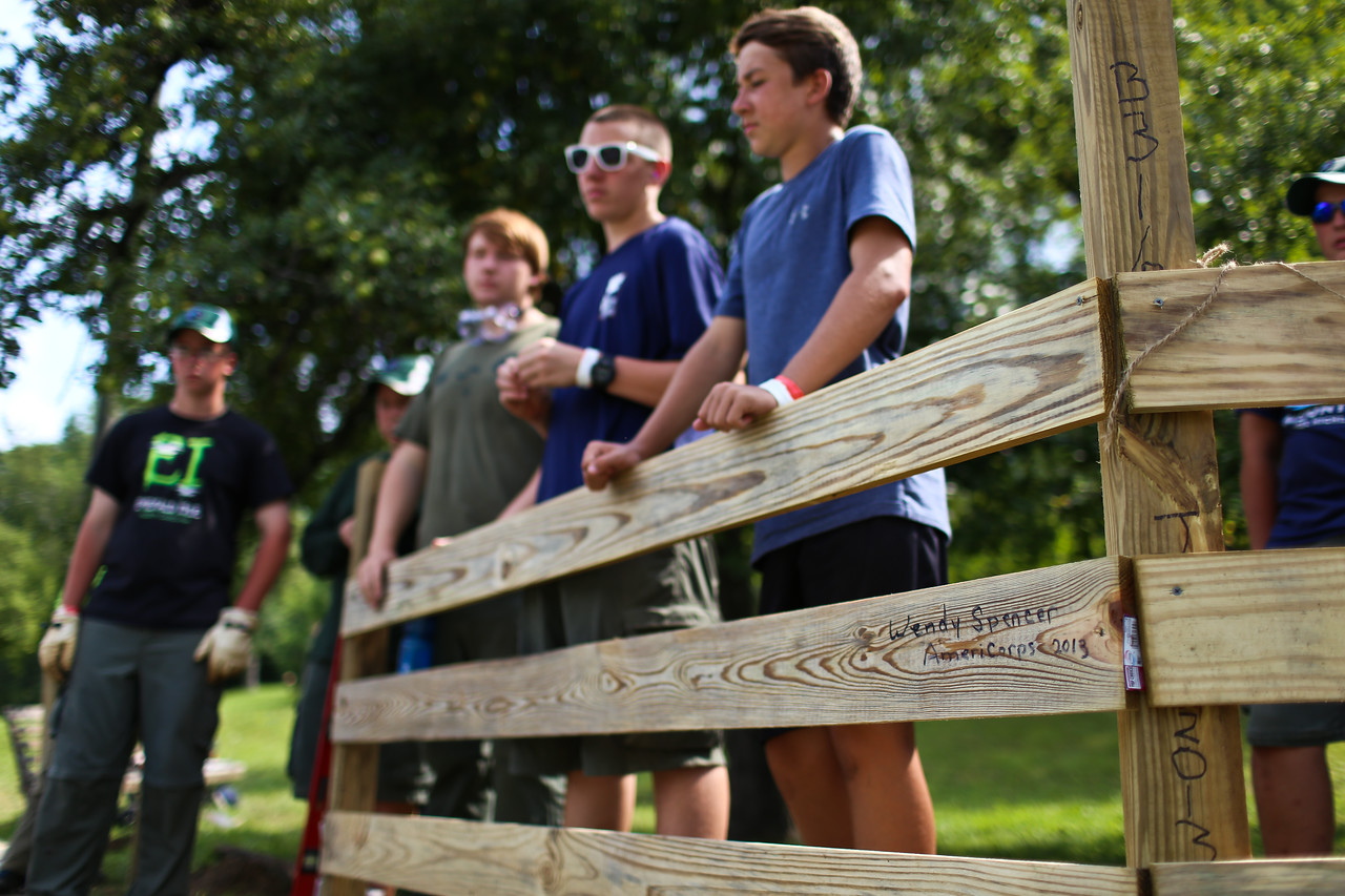 Boy Scouts finishing erecting a fence in West Virginia as part of a service project. Corporation for National and Community Service Photo.