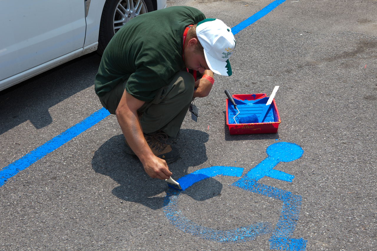 Boy Scout painting new handicap parking symbols at a park in West Virginia. Corporation for National and Community Service Photo.