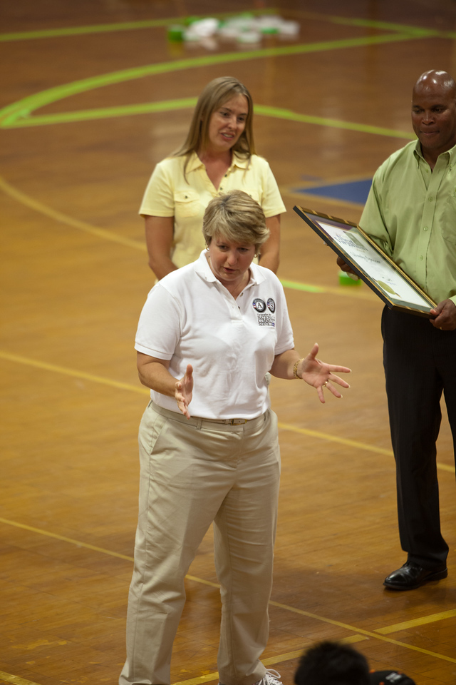 CNCS CEO, Wendy Spencer speaking to WVU football team and boy scouts at a service project at a gymnasium in Summersville, WV.  Corporation for National and Community Service Photo.