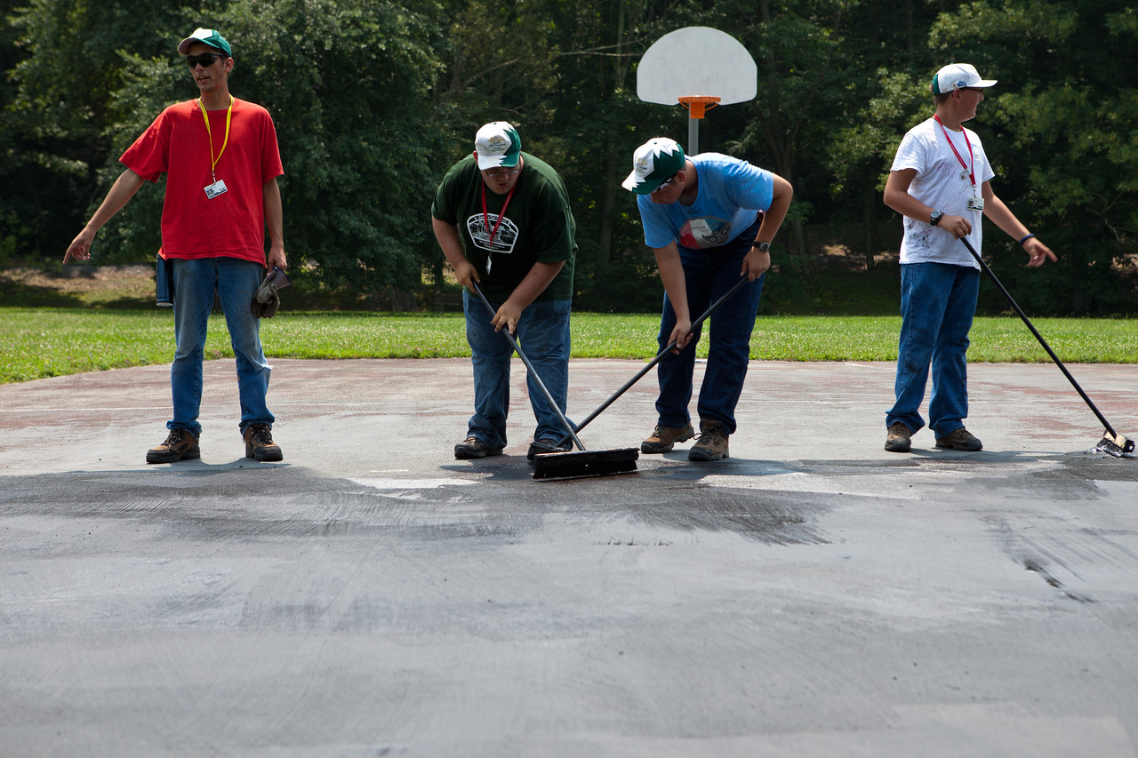 Boy Scouts tarring a new black top at a park in West Virginia. Corporation for National and Community Service Photo.